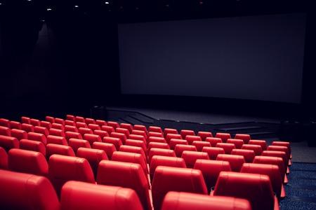 Foto de entertainment and leisure concept - movie theater or cinema empty auditorium with red seats - Imagen libre de derechos