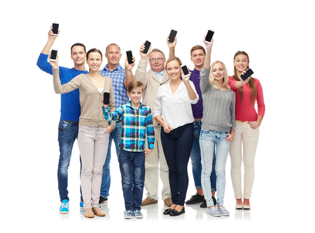 Foto de family, technology, generation and people concept - group of smiling men, women and boy smartphones - Imagen libre de derechos