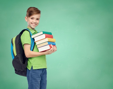 Photo for happy smiling student boy with school bag and books over green school chalk board background - Royalty Free Image