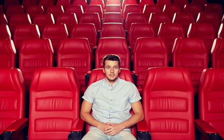 Foto de happy young man watching movie alone in empty theater auditorium - Imagen libre de derechos