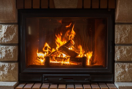Photo for heating, warmth, fire and cosiness concept - close up of burning fireplace at home - Royalty Free Image