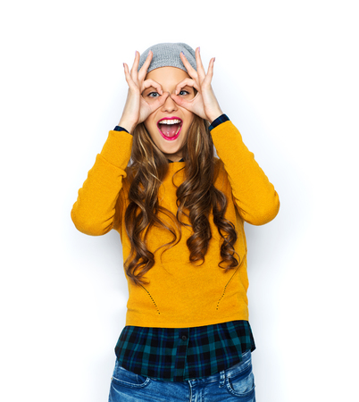 Photo for people, style and fashion concept - happy young woman or teen girl in casual clothes and hipster hat having fun - Royalty Free Image