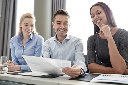 Foto de business, people and teamwork concept - group of smiling businesspeople meeting in office - Imagen libre de derechos