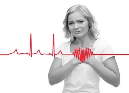 Foto de people, healthcare, heart disease and problem concept - unhappy woman suffering from heartache - Imagen libre de derechos