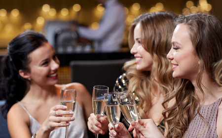 Photo for celebration, friends, bachelorette party and holidays concept - happy women with champagne glasses at night club - Royalty Free Image