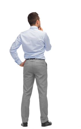 Foto de business, people, dilemma, rear view and office concept - businessman thinking from back - Imagen libre de derechos