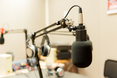 Photo for technology, electronics and audio equipment concept - close up of microphone at recording studio or radio station - Royalty Free Image