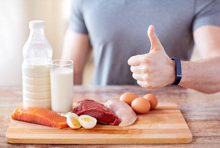 Photo for sport, fitness, healthy lifestyle, diet and people concept - close up of man with food rich in protein showing thumbs up - Royalty Free Image