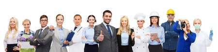 Photo for people, profession, qualification, employment and success concept - happy businessman over professional workers showing thumbs up - Royalty Free Image