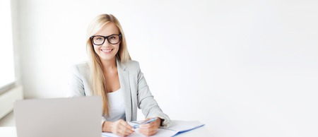Photo pour business and education concept - indoor picture of smiling woman with documents and pen - image libre de droit