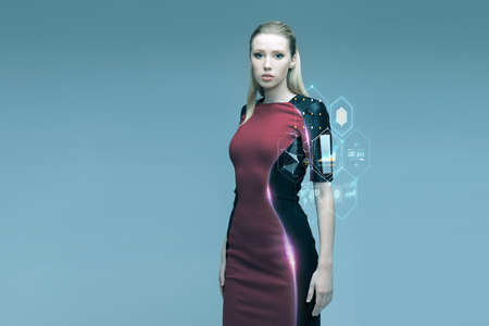 Foto de people, future technology and science concept - beautiful futuristic woman with virtual projection over gray background - Imagen libre de derechos