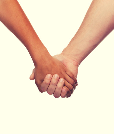 Photo for love and relationships concept - closeup of woman and man holding hands - Royalty Free Image