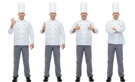 Foto de cooking, profession, gesture and people concept - happy male chef cook showing ok and thumbs up hand sign - Imagen libre de derechos