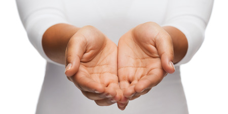 Photo for people and advertisement concept - close up of womans cupped hands showing something - Royalty Free Image