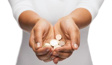 Foto de money and finances concept - close up of womans cupped hands showing euro coins - Imagen libre de derechos
