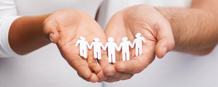 Photo pour relationships and love concept - closeup of couple hands showing paper cutout team - image libre de droit