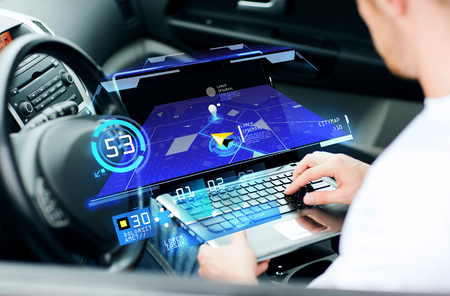 Photo for transport, modern technology and people concept - man using navigation system on laptop computer in car - Royalty Free Image