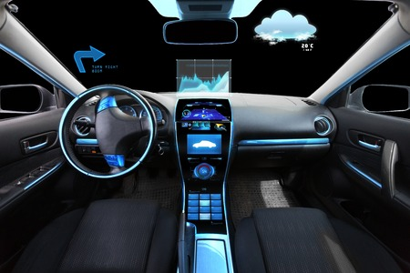 Foto de transport, destination and modern technology concept - car salon with navigation system on dashboard and meteo sensor on windshield - Imagen libre de derechos