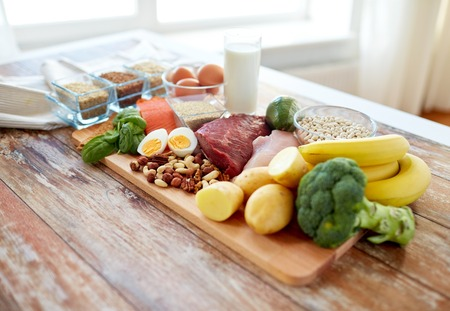 Photo pour balanced diet, cooking, culinary and food concept - close up of vegetables, fruit and meat on wooden table - image libre de droit