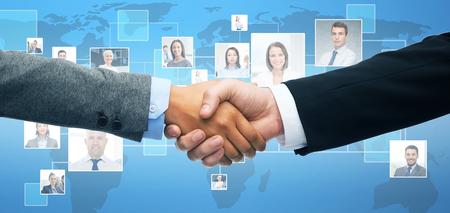 Photo pour business and office concept - businessman and businesswoman shaking hands - image libre de droit