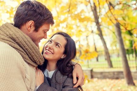Photo pour love, relationship, family and people concept - smiling couple hugging in autumn park - image libre de droit