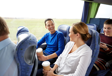 Photo pour transport, tourism, road trip and people concept - group of happy passengers or tourists in travel bus - image libre de droit