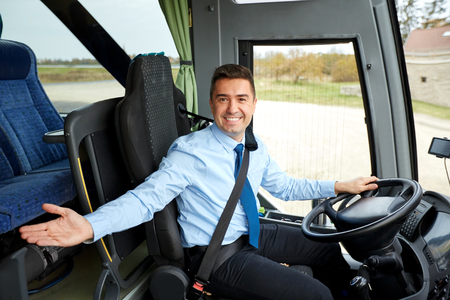 Photo pour transport, tourism, road trip, gesture and people concept - happy driver inviting on board of intercity bus - image libre de droit