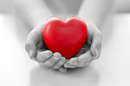 Photo pour people, love, charity and family concept - close up of child hands holding red heart shape at home - image libre de droit