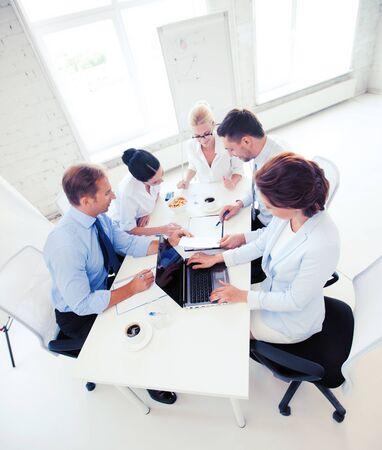 Photo pour business concept - friendly business team having meeting in office - image libre de droit