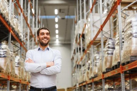 Photo pour wholesale, logistic, business, export and people concept - happy man at warehouse - image libre de droit
