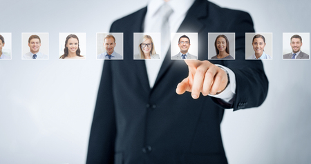 Photo for human resources, career management, recruitment and success concept - man in suit pointing to of many business people portraits - Royalty Free Image