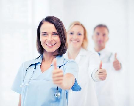Foto de healthcare and medical concept - team of doctors showing thumbs up - Imagen libre de derechos