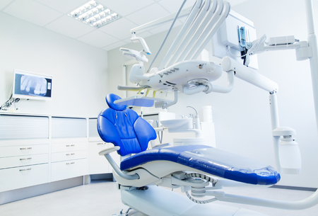 Foto de dentistry, medicine, medical equipment and stomatology concept - interior of new modern dental clinic office with chair - Imagen libre de derechos