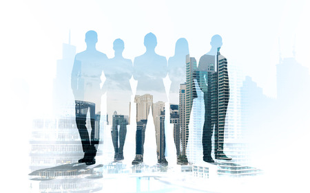 Photo pour business, teamwork and people concept - business people silhouettes over city background with double exposure effect - image libre de droit