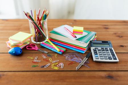Foto de education, school supplies, art, creativity and object concept - close up of stationery on wooden table - Imagen libre de derechos