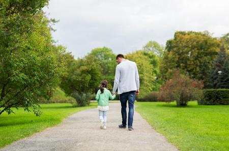 Photo for family, parenthood, fatherhood, adoption and people concept - happy father and little girl walking in summer park - Royalty Free Image