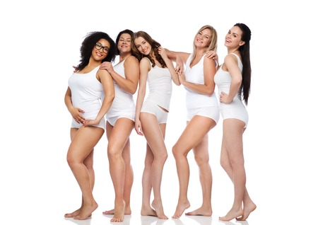 Foto de friendship, beauty, body positive and people concept - group of happy women different in white underwear - Imagen libre de derechos