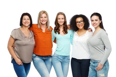 Foto de friendship, fashion, body positive, diverse and people concept - group of happy different size women in casual clothes - Imagen libre de derechos