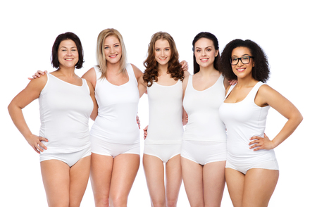 Foto per friendship, beauty, body positive and people concept - group of happy women different in white underwear - Immagine Royalty Free