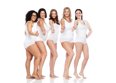 Photo pour gesture, friendship, beauty, body positive and people concept - group of happy different women in white underwear showing thumbs up - image libre de droit