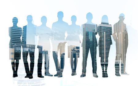 Foto de business, teamwork and people concept - business people silhouettes over city background with double exposure effect - Imagen libre de derechos