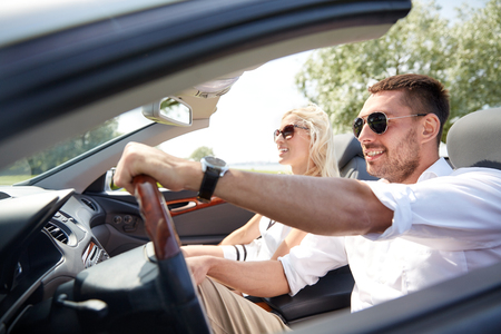 Photo pour road trip, travel, dating, couple and people concept - happy man and woman driving in cabriolet car outdoors - image libre de droit
