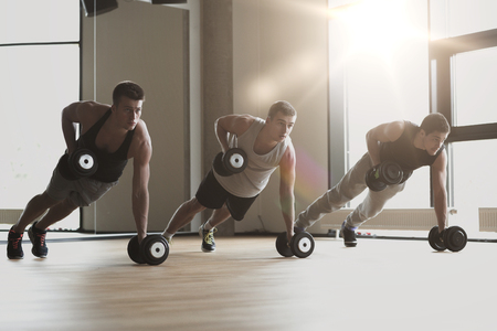 Photo for sport, fitness, lifestyle and people concept - group of men with dumbbells in gym - Royalty Free Image