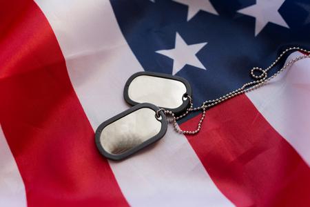 Foto de military forces, military service, patriotism and nationalism concept - close up of american flag and soldiers badges - Imagen libre de derechos