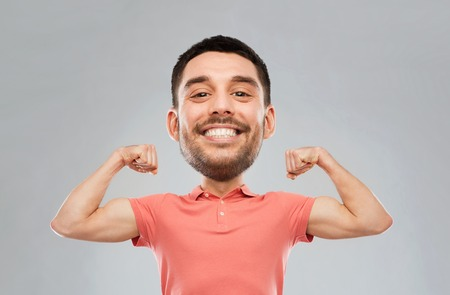 Photo pour power, fitness, strength, sport and people concept - happy smiling young man showing biceps over gray background (funny cartoon style character with big head) - image libre de droit