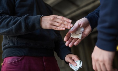 Foto de drug trafficking, crime, addiction and sale concept - close up of addict buying dose from drug dealer on street - Imagen libre de derechos