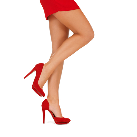 Photo pour people, fashion and footwear concept - close up of woman legs in red high heeled shoes - image libre de droit