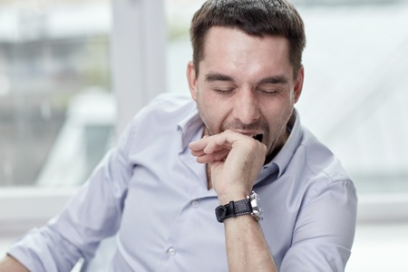 Photo pour people and tiredness concept - yawning tired man at home or office - image libre de droit