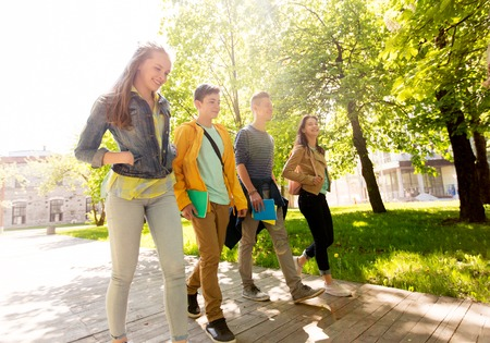 Photo pour education, high school, learning and people concept - group of happy teenage students walking outdoors - image libre de droit