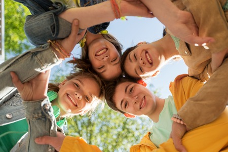 Photo for friendship and people concept - group of happy teenage friends holding hands outdoors - Royalty Free Image